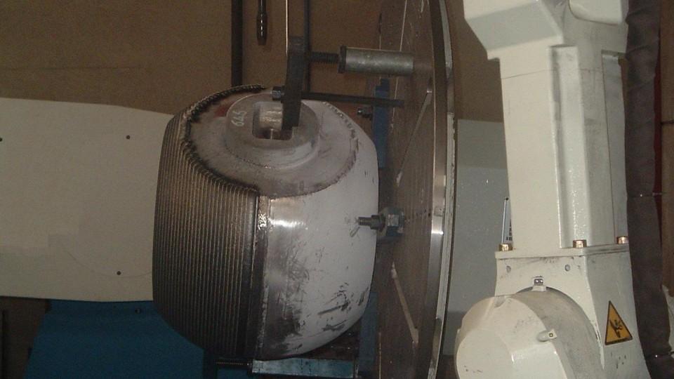 Riporto su sfera mediante impianto robotizzato