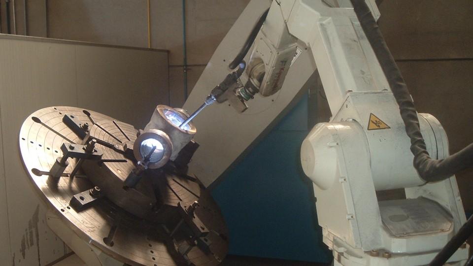 """Riporto su corpo """"top entry"""" da 6'' mediante impianto robotizzato"""